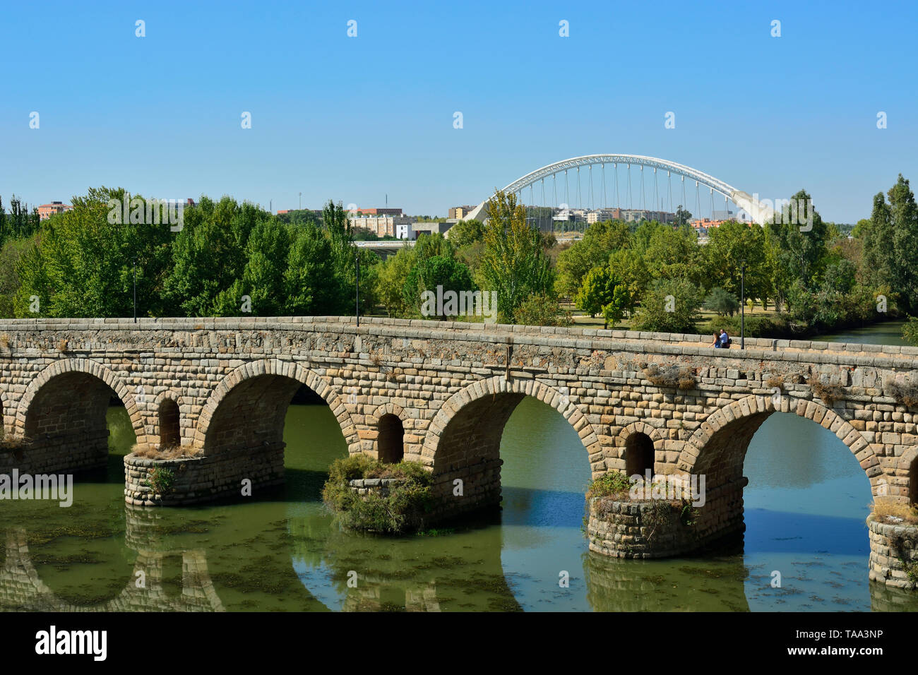 The Puente Romano (Roman Bridge) over the Guadiana river, dating back to the 1st century BC. It is the world's longest bridge from ancient times. A Un - Stock Image
