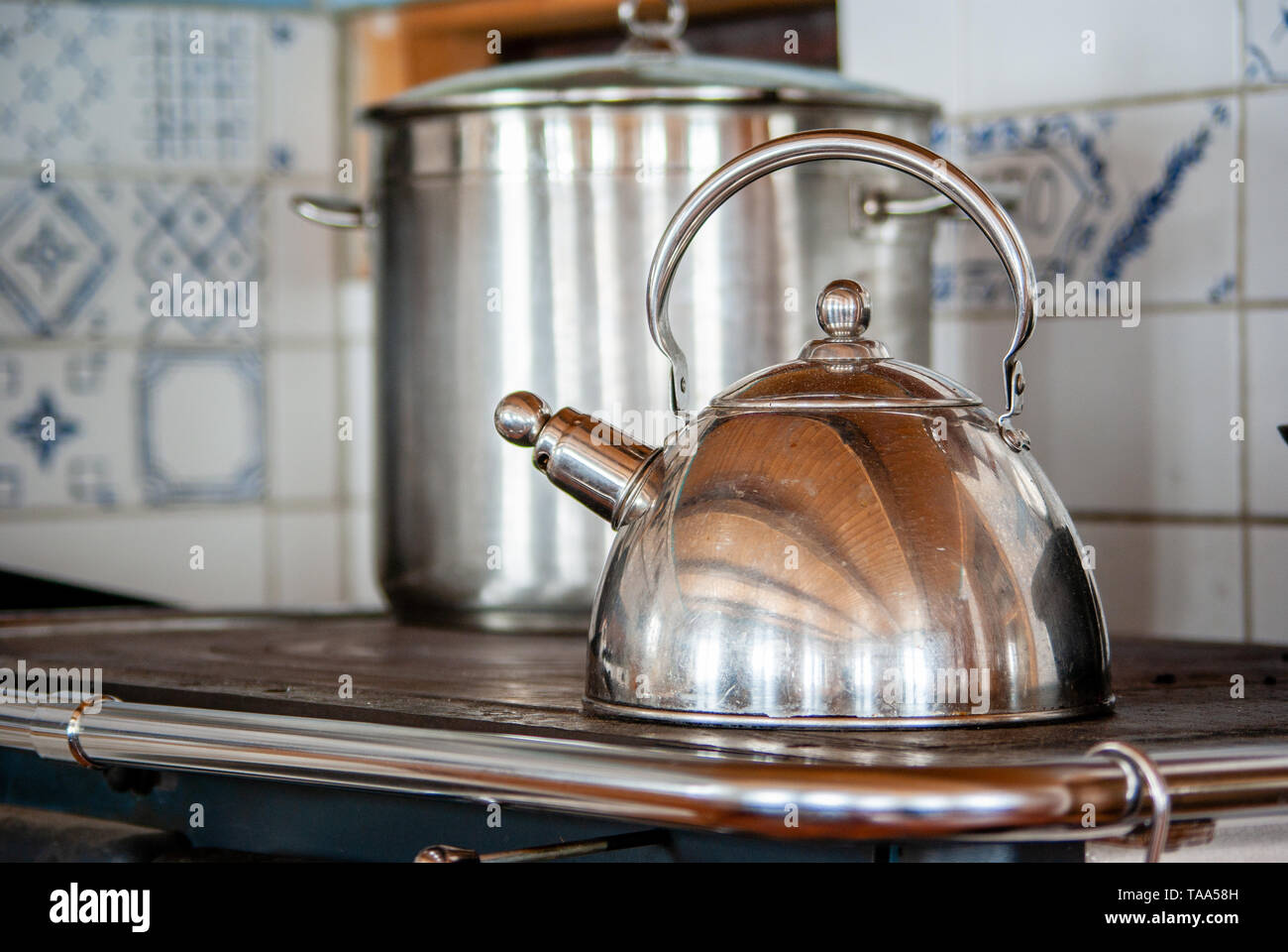 pot and kettle on the wood fired stove - Stock Image