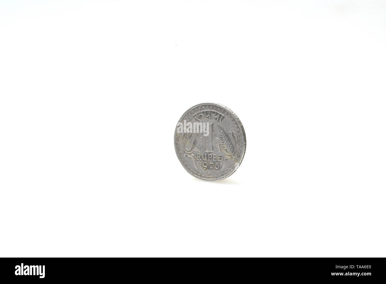 one rupee coin on white background, India, Asia, 1975 - Stock Image
