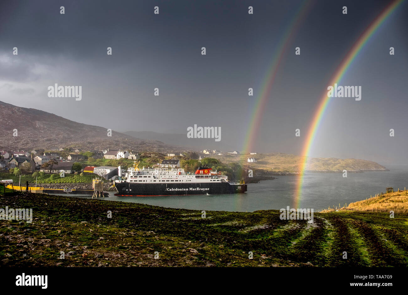 MV Hebrides docks at Tarbert, Harris, Outer Hebrides with rainbows - Stock Image