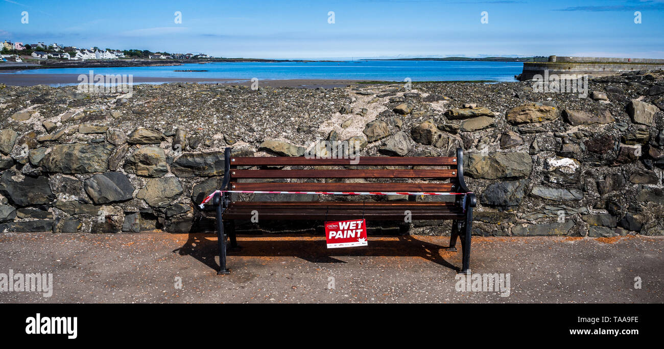WET PAINT - bench on seafront at Donaghadee - Stock Image