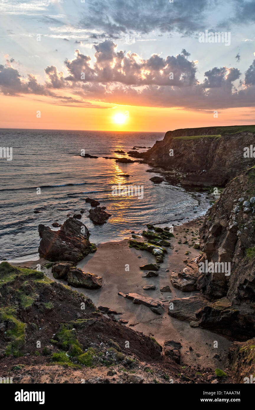 Cliffs and bay at Skaw, Unst, Shetland - Stock Image