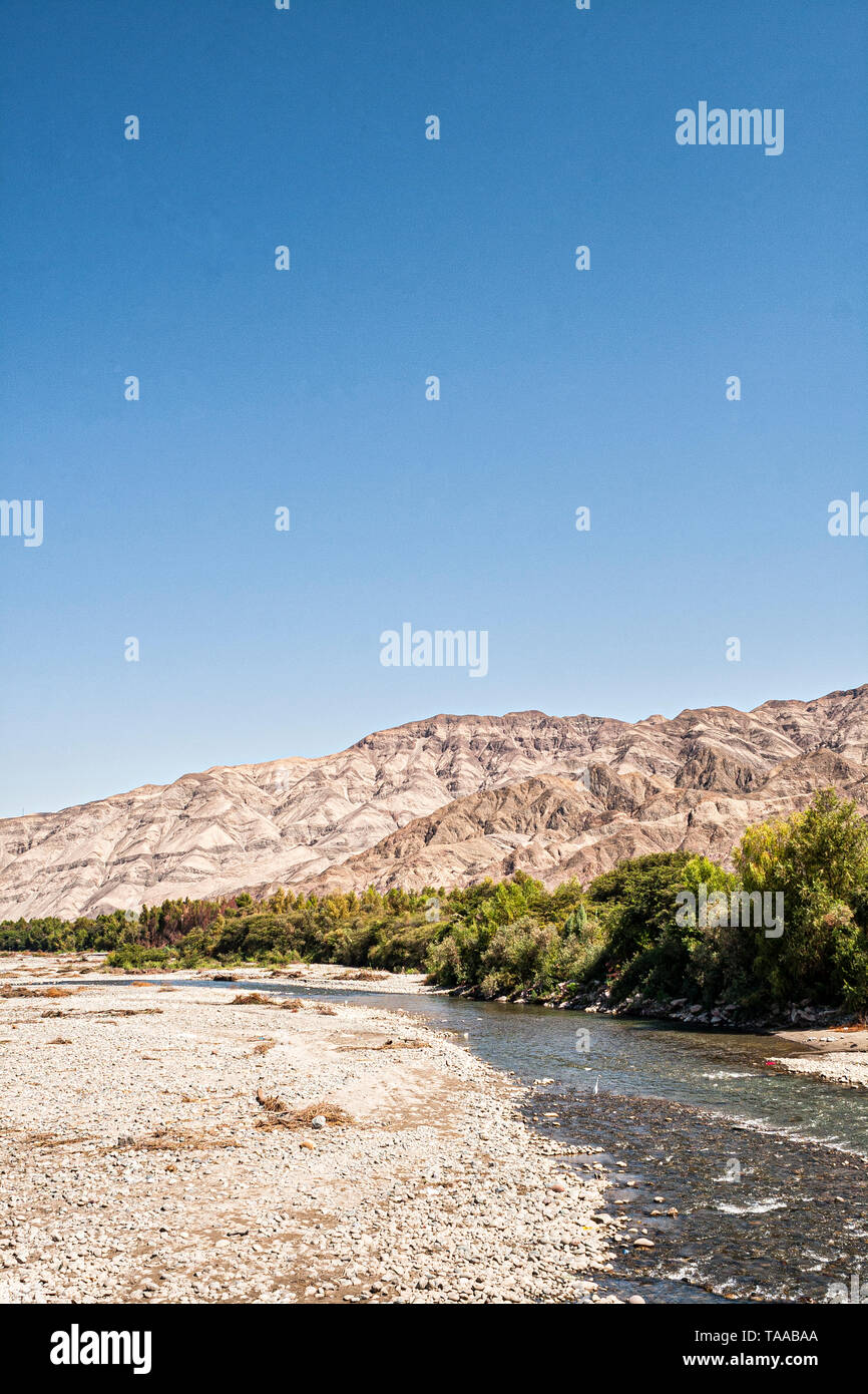 Rio Grande, one of the rivers that cross Peruvian desert. Palpa, Department of Ica, Peru. - Stock Image