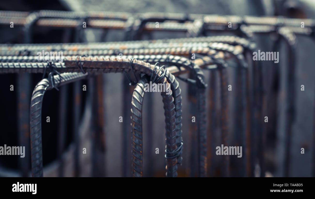 Dowel bar reinforcement concrete footing construction in process preparation industry abstract teamwork business. - Stock Image
