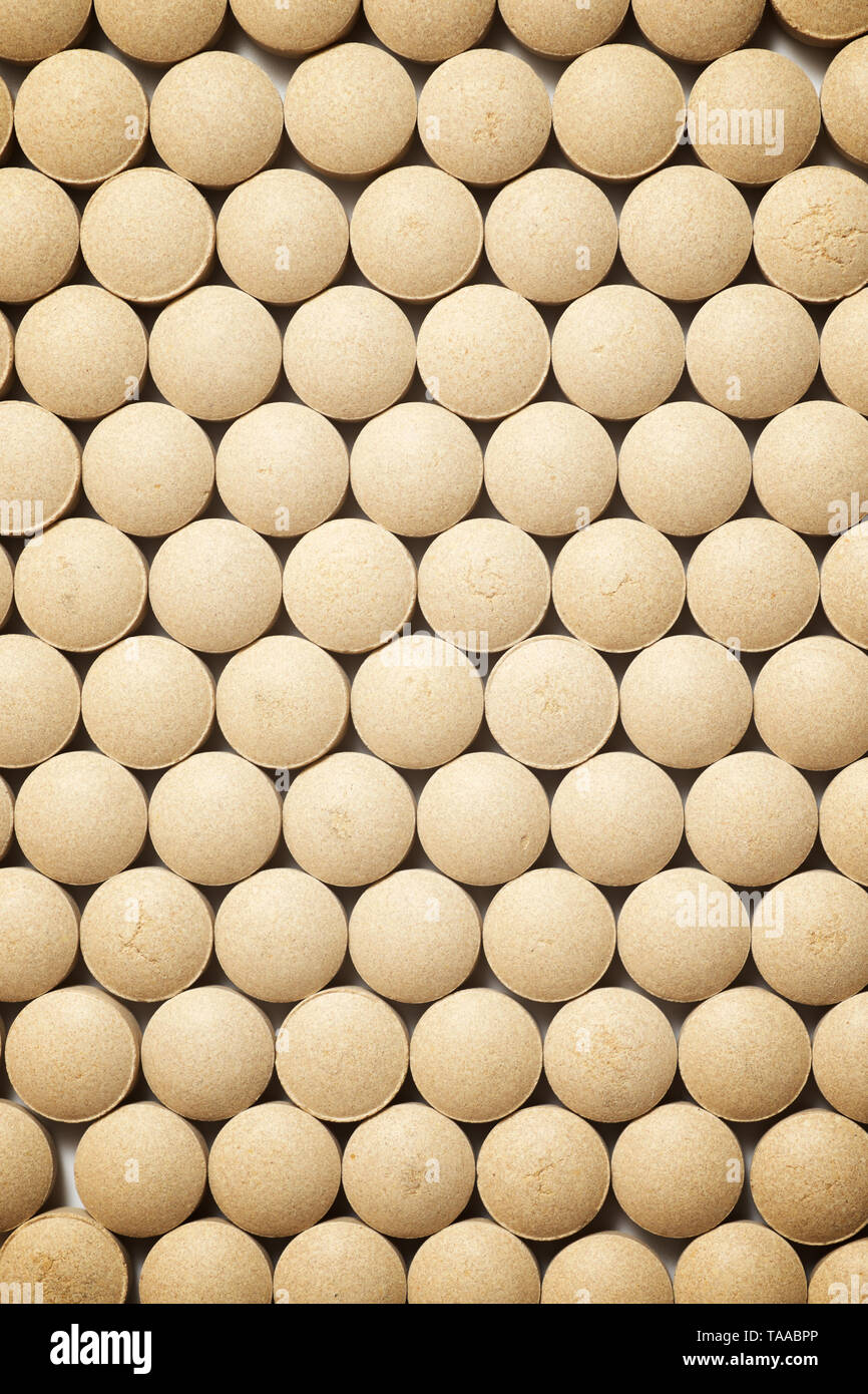Many beer yeast pills on a table. - Stock Image