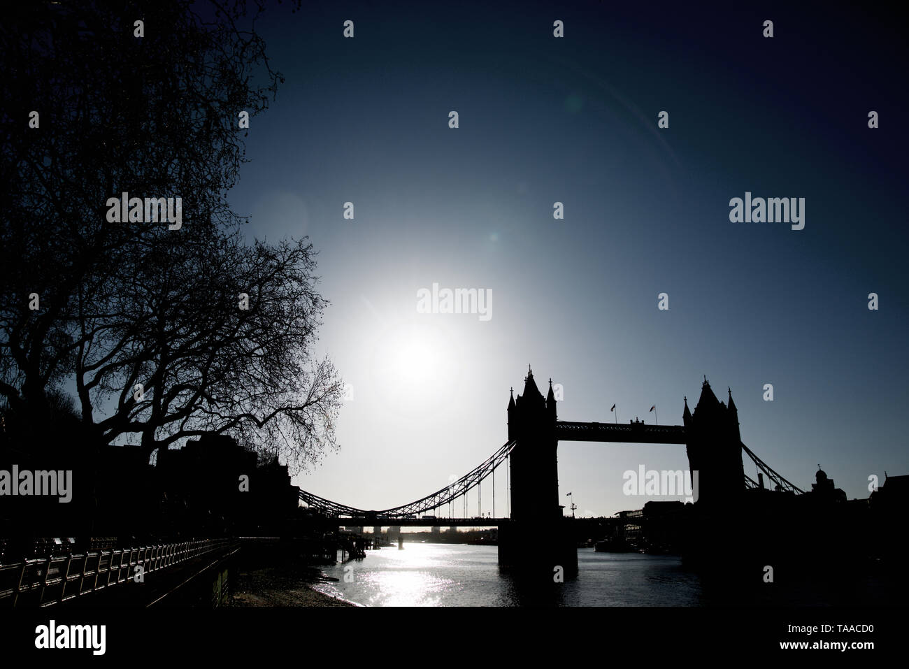 Tower Bridge on the banks of Thames river in London. Stock Photo