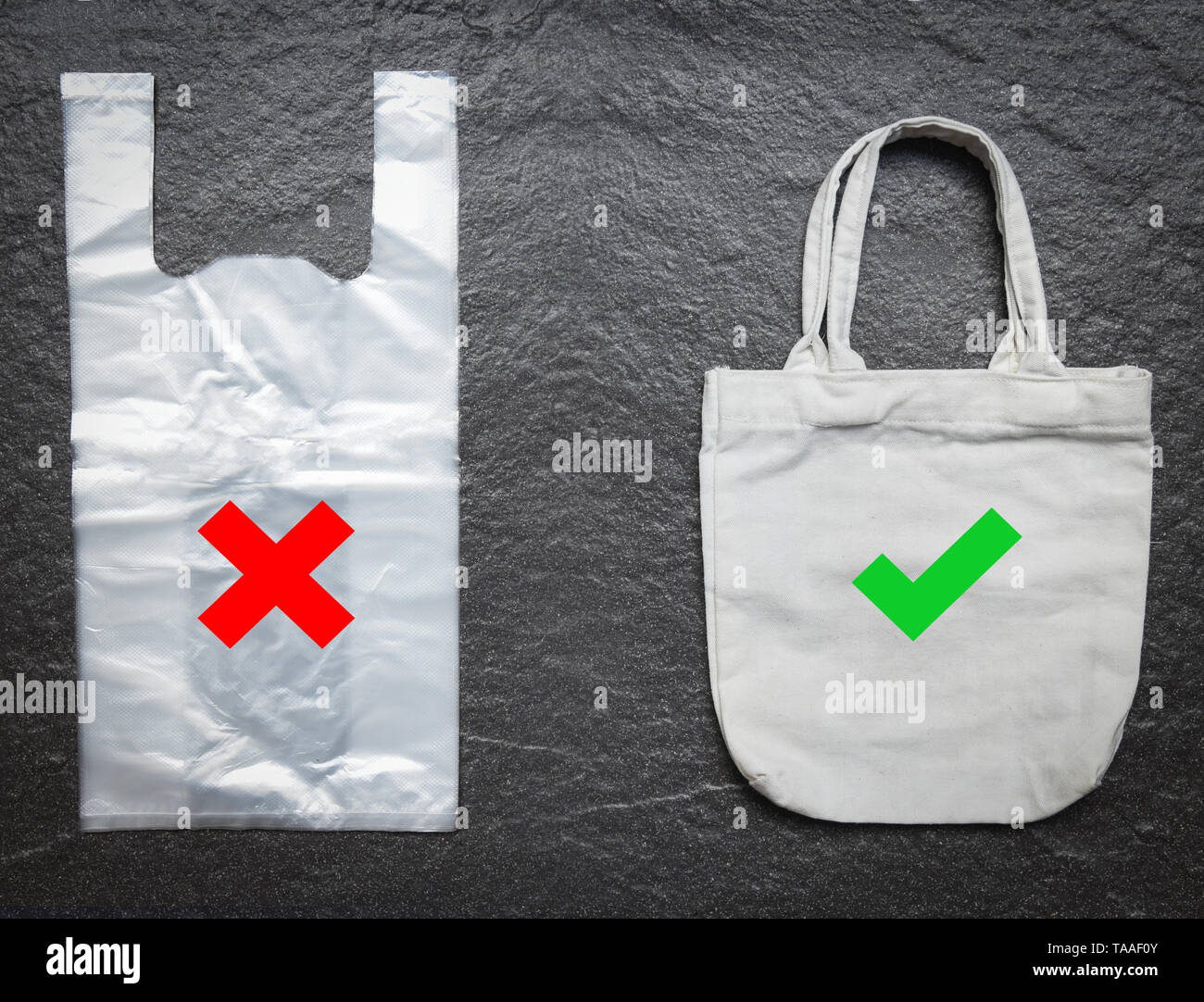 No plastic bag / Use tote bag canvas fabric cloth shopping replace say no to plastic bags on stone dark background - Pollution problem concept - Stock Image