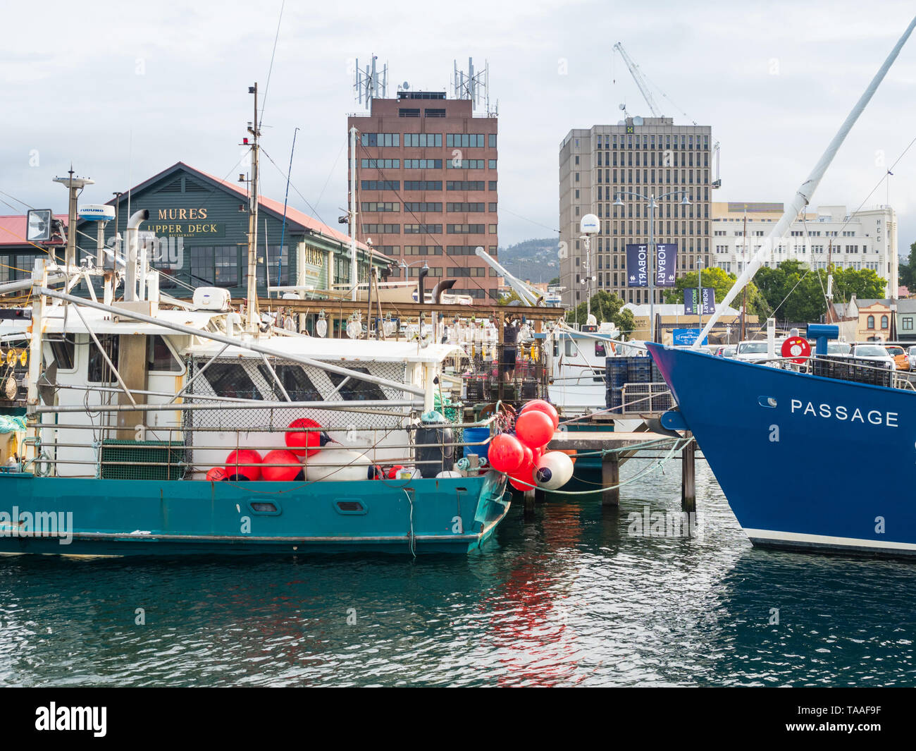 TASMANIA, AUSTRALIA - FEBRUARY 16, 2019: Fishing boats moored at Elizabeth Street Pier in Hobart, Tasmania, Australia. Stock Photo