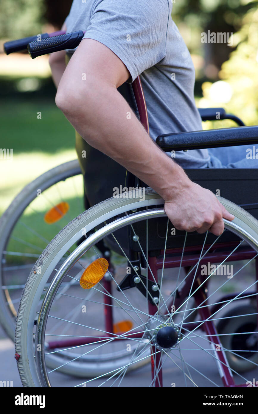 Close-up of man on wheelchair in a park - Stock Image