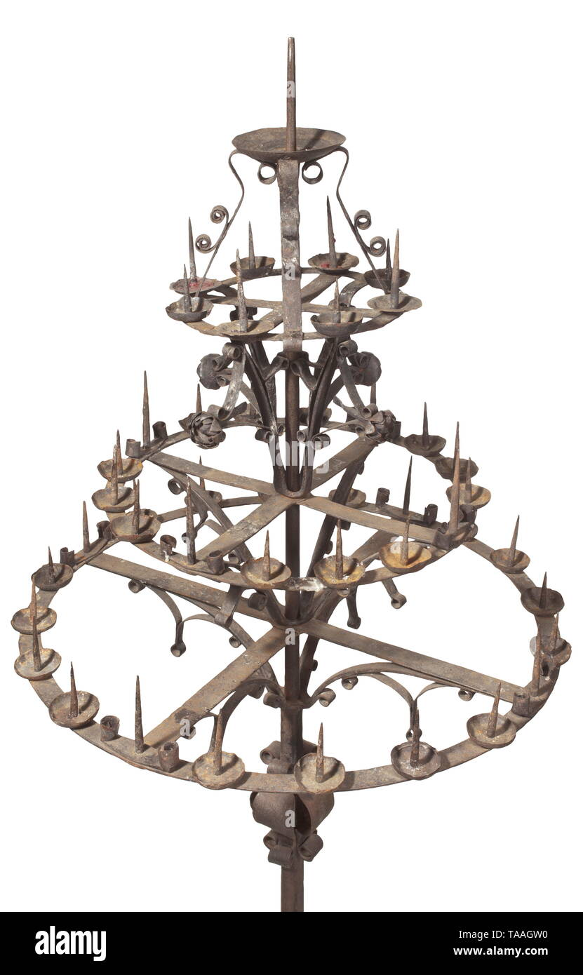 A large South German wrought iron wheel candelabrum, 17th century Elaborately crafted iron candelabrum with candle holders in three levels. Robust stem on three feet with ornamental baluster clasps. Attached to it a large wheel with 20 prickets and eight candle sockets, the middle wheel with 16 prickets and eight sockets. The top level with eight prickets and four wrought rosettes. Height 195 cm, diameter 85 cm. historic, historical, handicrafts, handcraft, craft, object, objects, stills, clipping, clippings, cut out, cut-out, cut-outs, 17th cent, Additional-Rights-Clearance-Info-Not-Available - Stock Image