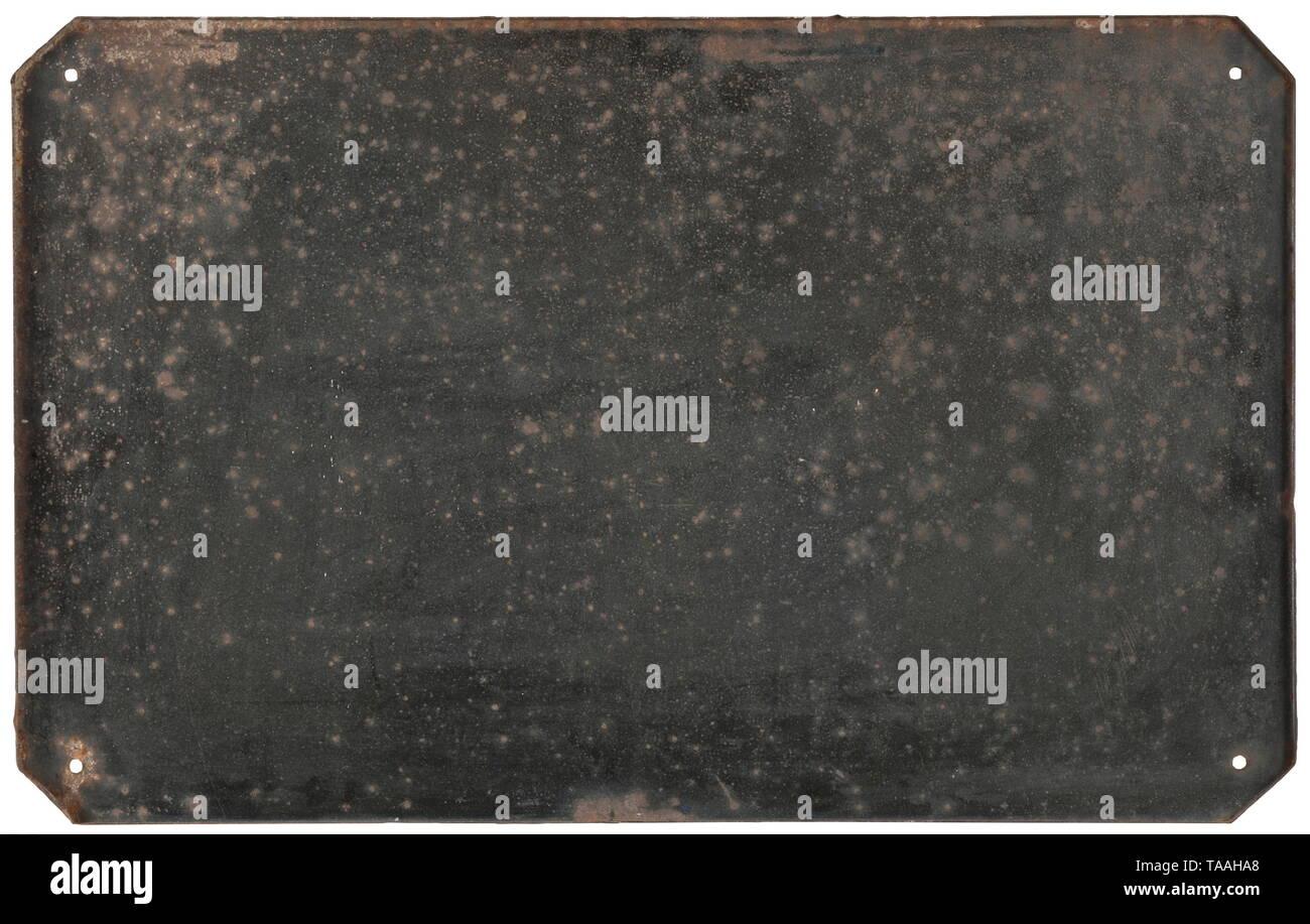 """An enamel sign """"Straße der SA"""" Rechteckige Form mit abgeschrägten Ecken, tiefblau emailliert mit weißer Schrift. Kleinere Emailleabplatzer, die Ränder etwas korrodiert, ansonsten in schöner und farbfrischer Erhaltung. Maße 47,5 x 75,5 cm. historic, historical, 20th century, Editorial-Use-Only Stock Photo"""