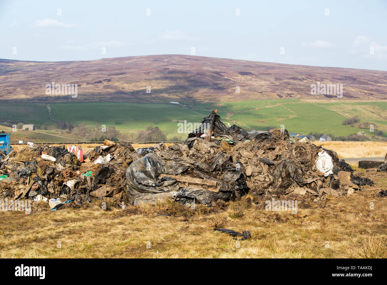Plastic famr waste dumped by the roadside in Bowland, UK. - Stock Image