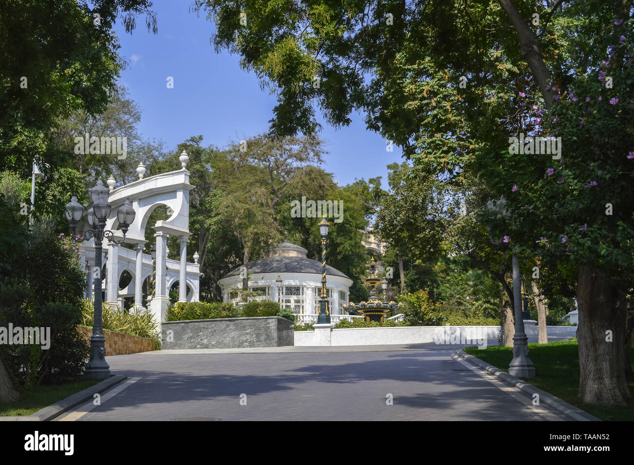 road entrance to main part of Philharmonic Fountain Park in Baku on sunny day - Stock Image