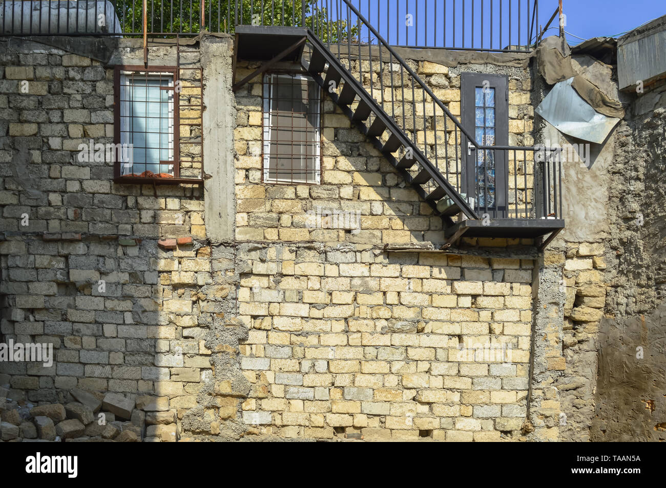 ruined house in  old city Baku with wall of another home - Stock Image