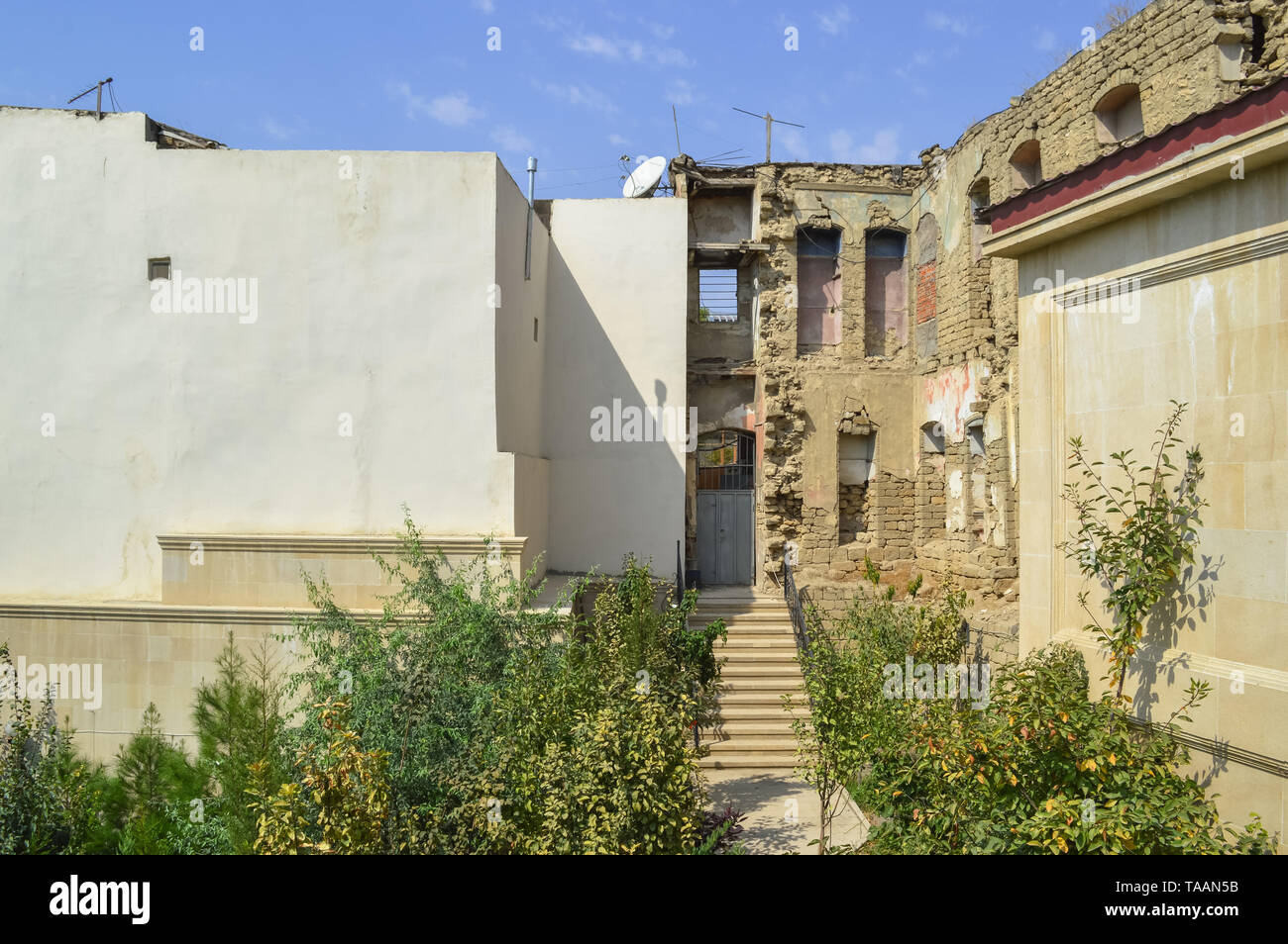 ruins of house in old city Baku on sunny day - Stock Image