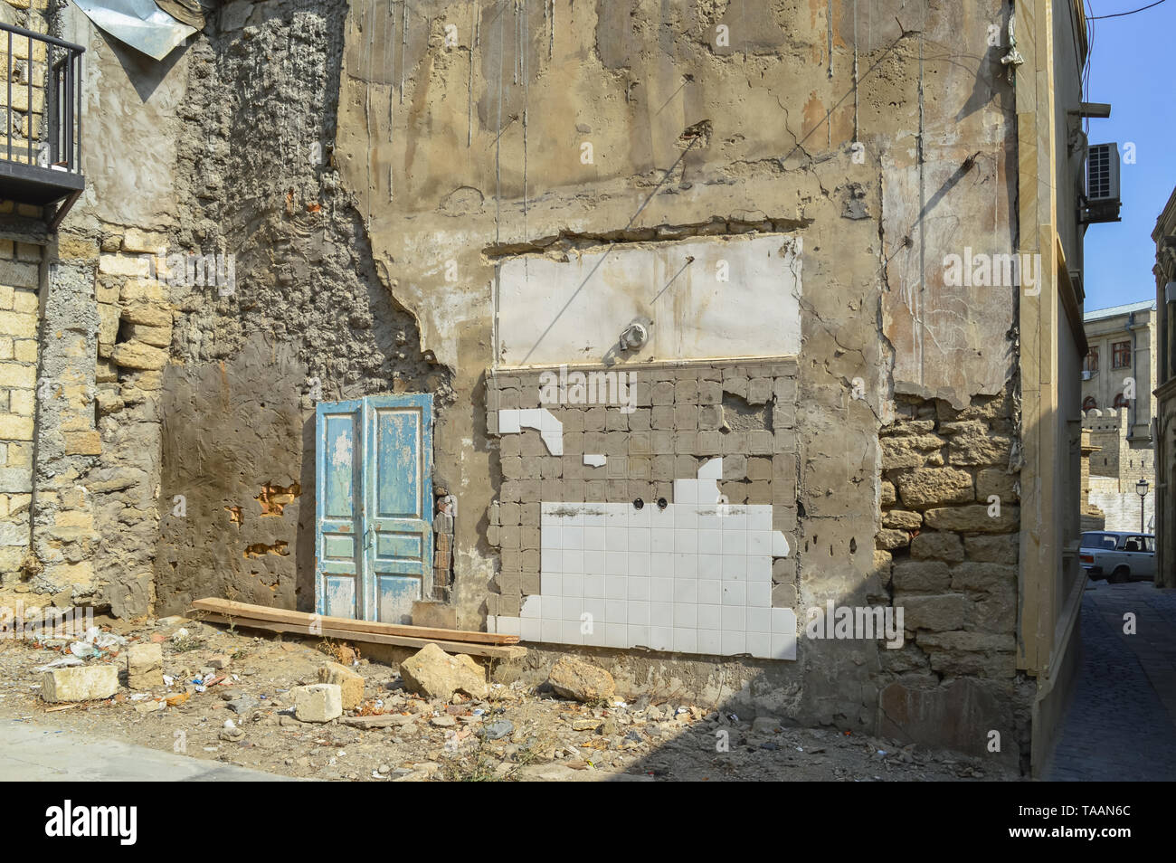 wall of demolished house in old city Baku - Stock Image