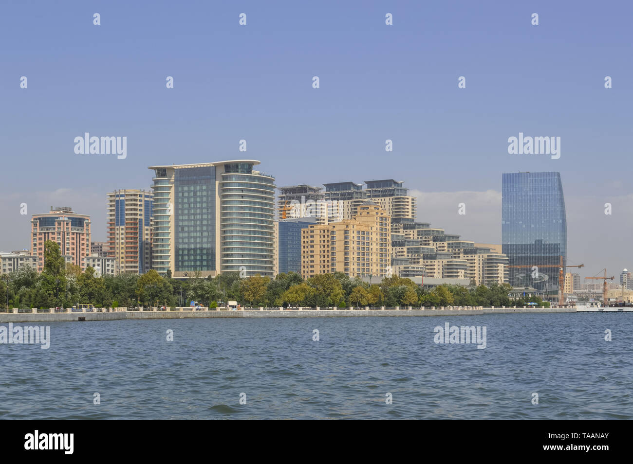 view from Caspian sea on modern buildings of Baku on sunny day - Stock Image