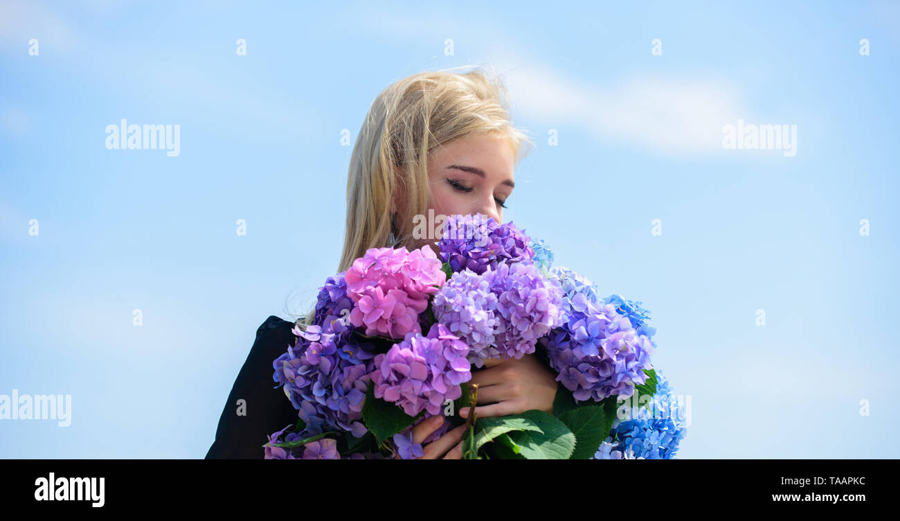 Pollen allergy. Enjoy spring without allergy. Gentle flower for delicate woman. Girl tender blonde hold hydrangea flowers bouquet. Allergy free life. Stop allergy blooming season. Springtime bloom. - Stock Image