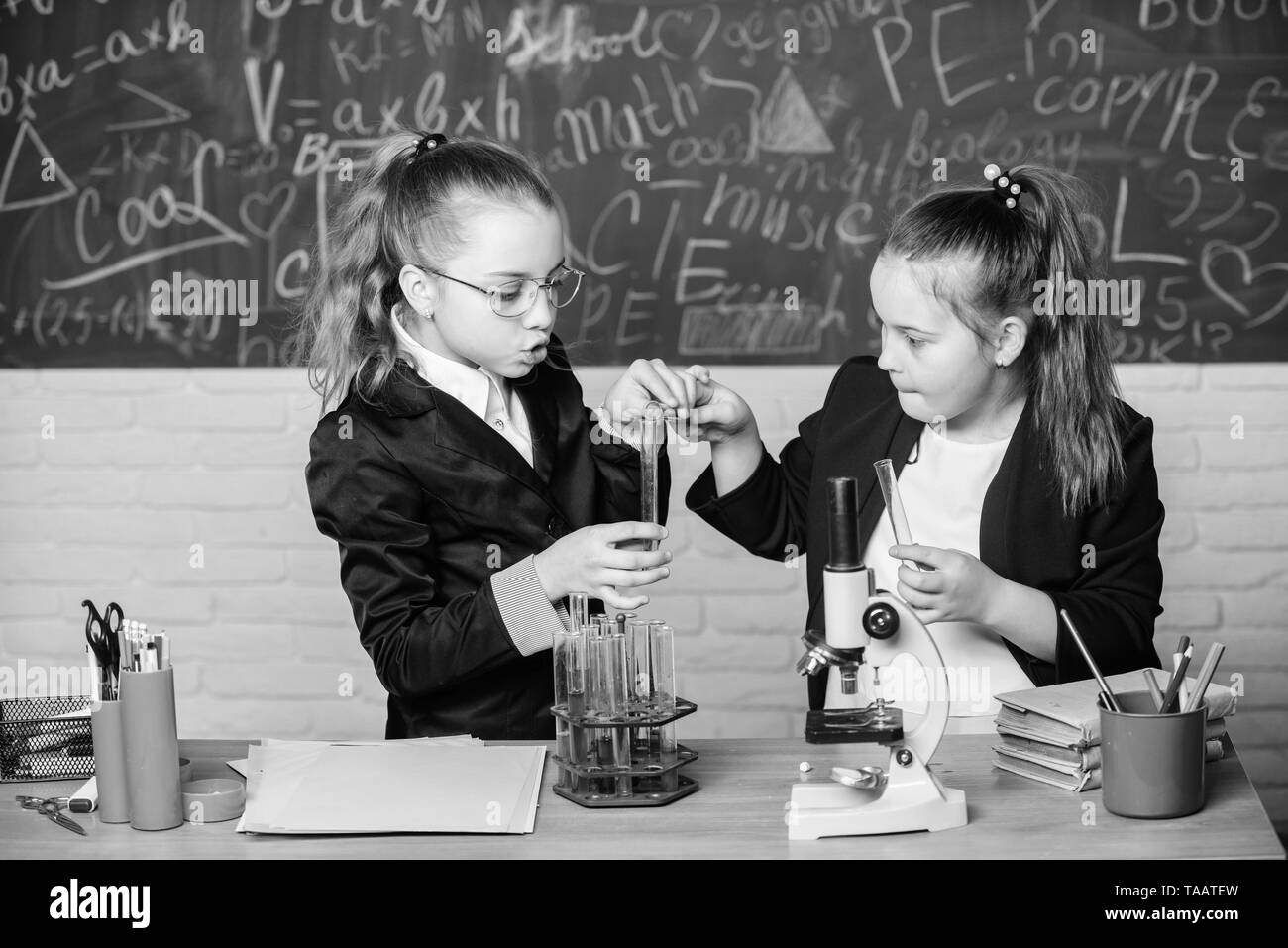 Make studying chemistry interesting educational experiment concept microscope and test tubes on table
