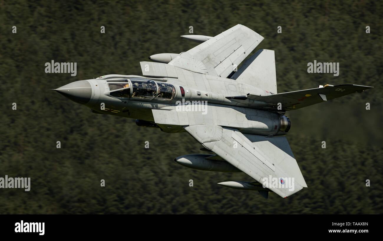 RAF Panavia Tornado GR4 jet flying low level through the Mach Loop, Wales, UK Stock Photo