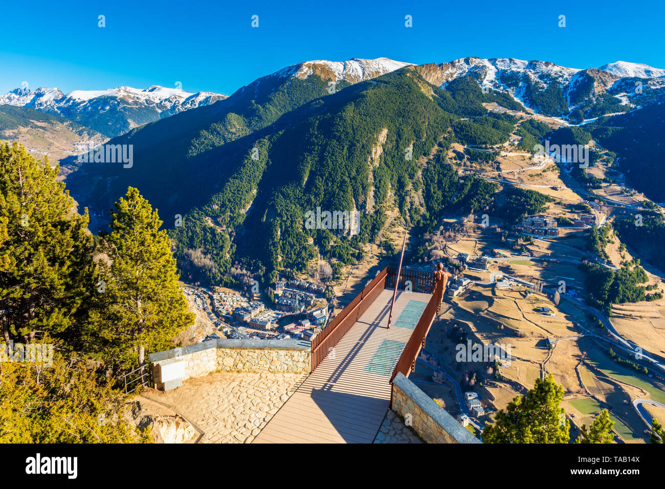 High angle viewpoint overlooking a valley in Andorra on sunny winterday in december - Stock Image
