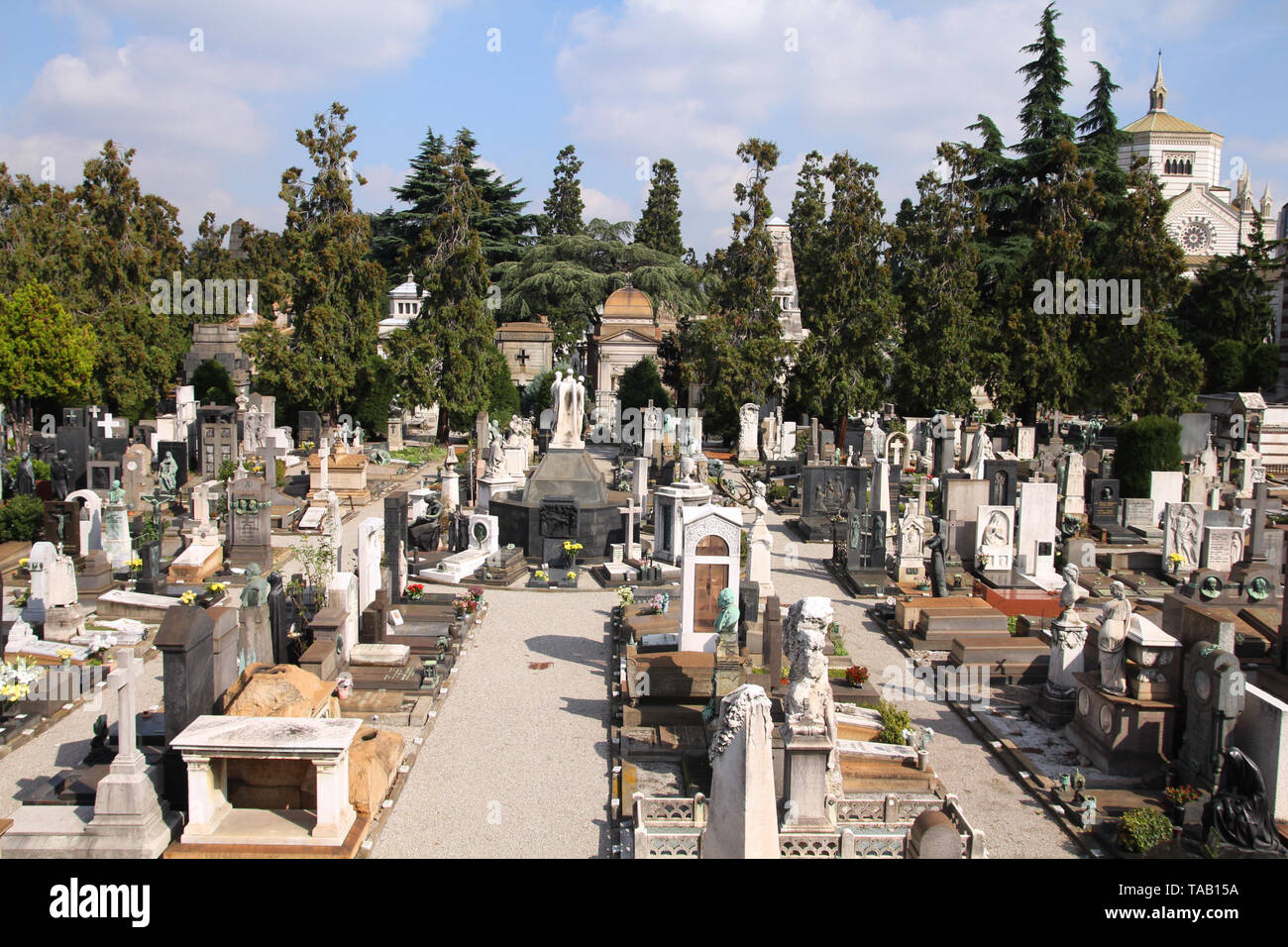 Milan, Italy. Famous landmark - the Monumental Cemetery (Cimitero Monumentale) with Famedio chapel in the background. - Stock Image