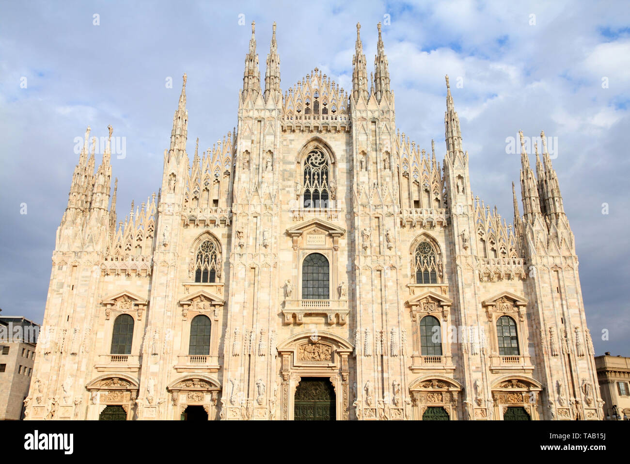 Cathedral of Milan. Catholic church in Italy. Gothic facade in sunset light. - Stock Image