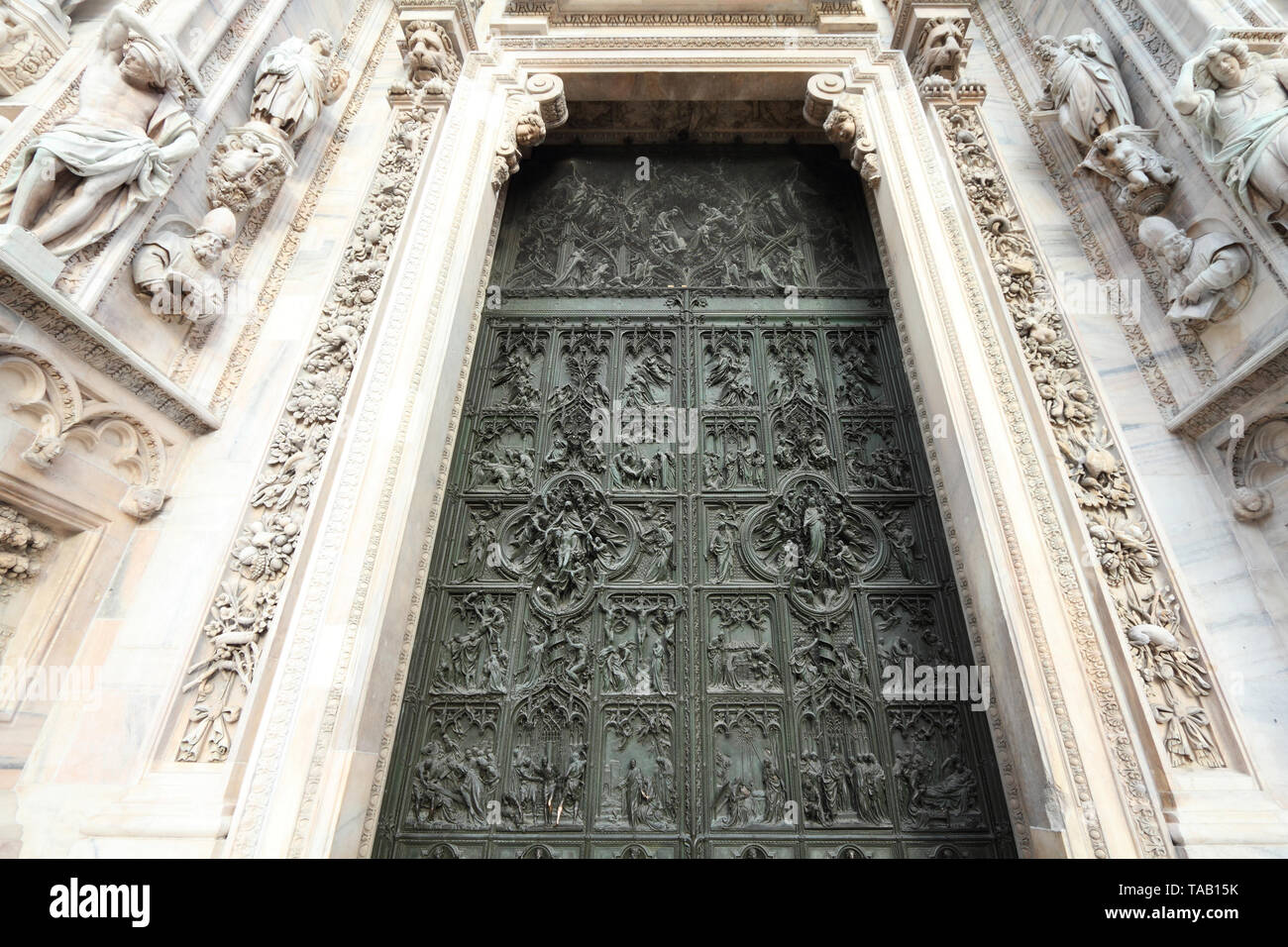Milan cathedral door detail - brass bas relief art. Architecture in Italy. - Stock Image