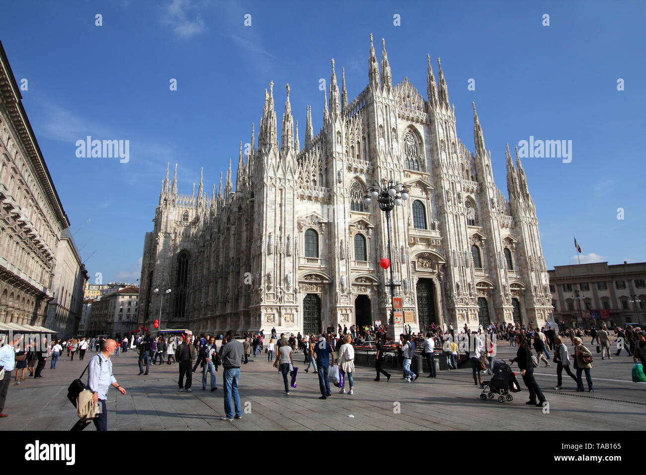 MILAN - OCTOBER 6: Tourists stroll at Piazza Duomo on October 6, 2010 in Milan, Italy. As of 2006, Milan was the 42nd most visited city worldwide, wit - Stock Image