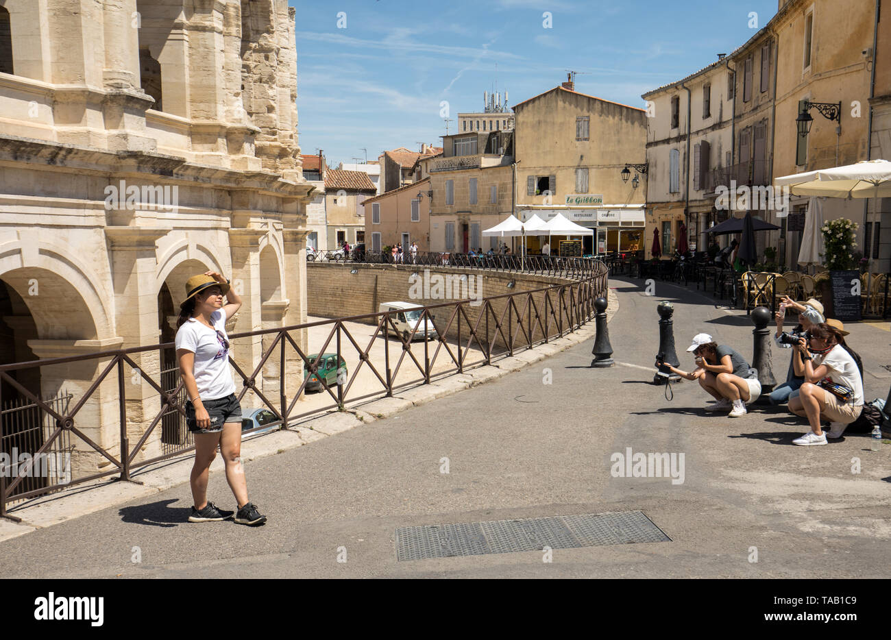 Arles, France - June 27, 2017: Photo session of tourists from Asia in front of the ruins of the Roman Arena in Arles - Stock Image
