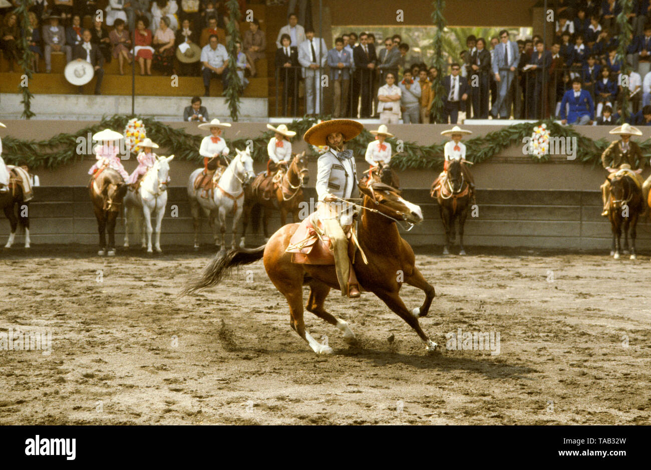 RODEO Mexico Riders on horseback show their skill - Stock Image