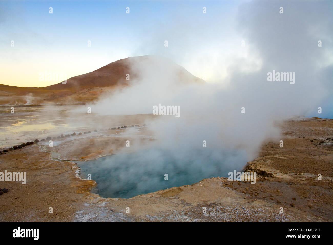 Natural hot spring pool at an altitude of 4300m, El Tatio Geysers, Atacama desert, Antofagasta Region, Chile, South America - Stock Image