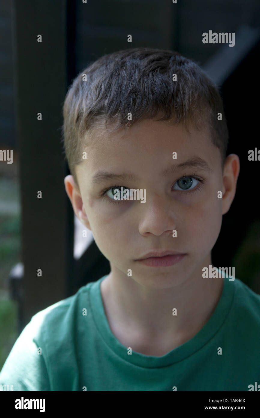portrait moody young boy - Stock Image