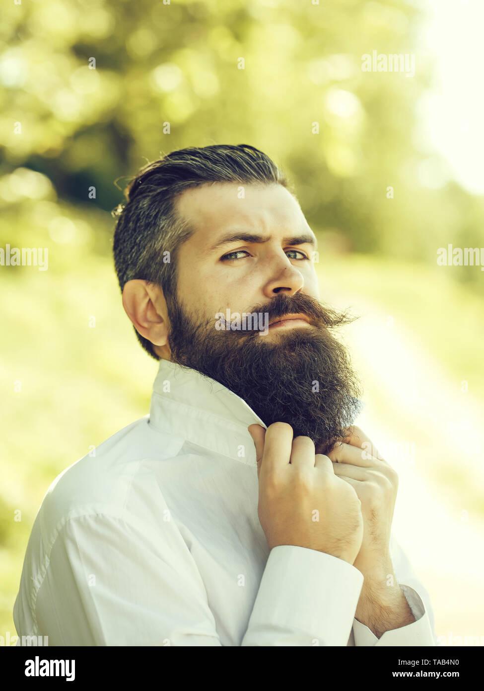 Bearded man on blue sky - Stock Image