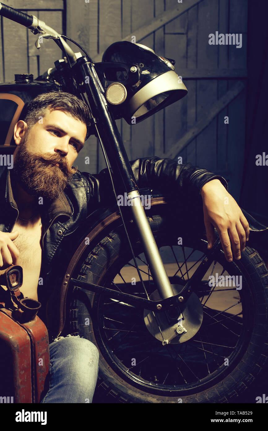 Bearded man hipster biker - Stock Image