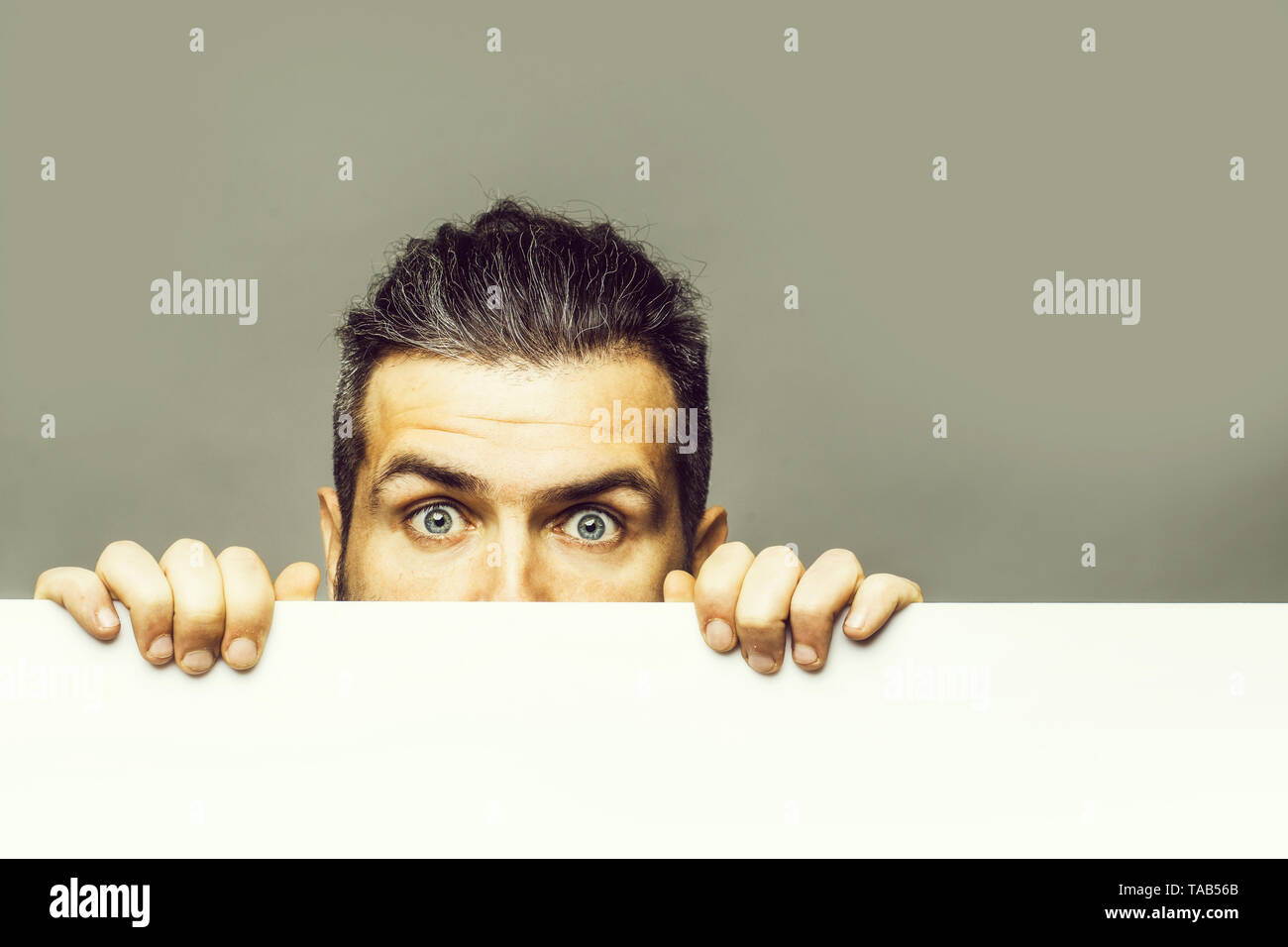 scared man with paper Stock Photo