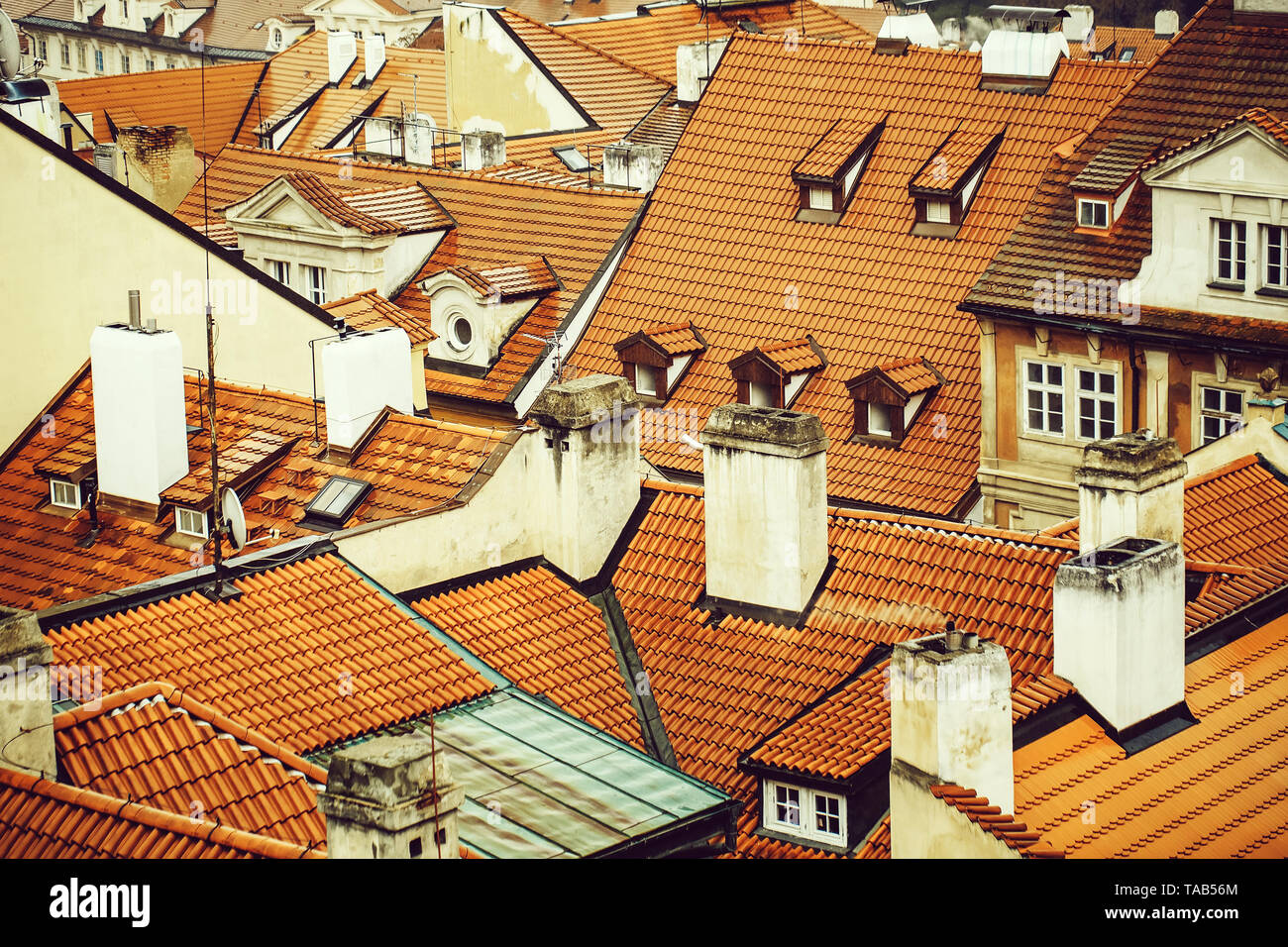 Terracotta tiled roofs with chimneys - Stock Image