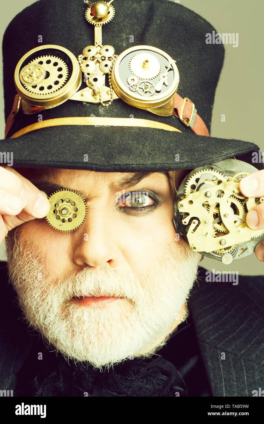 Man keeps cogwheel and gears - Stock Image