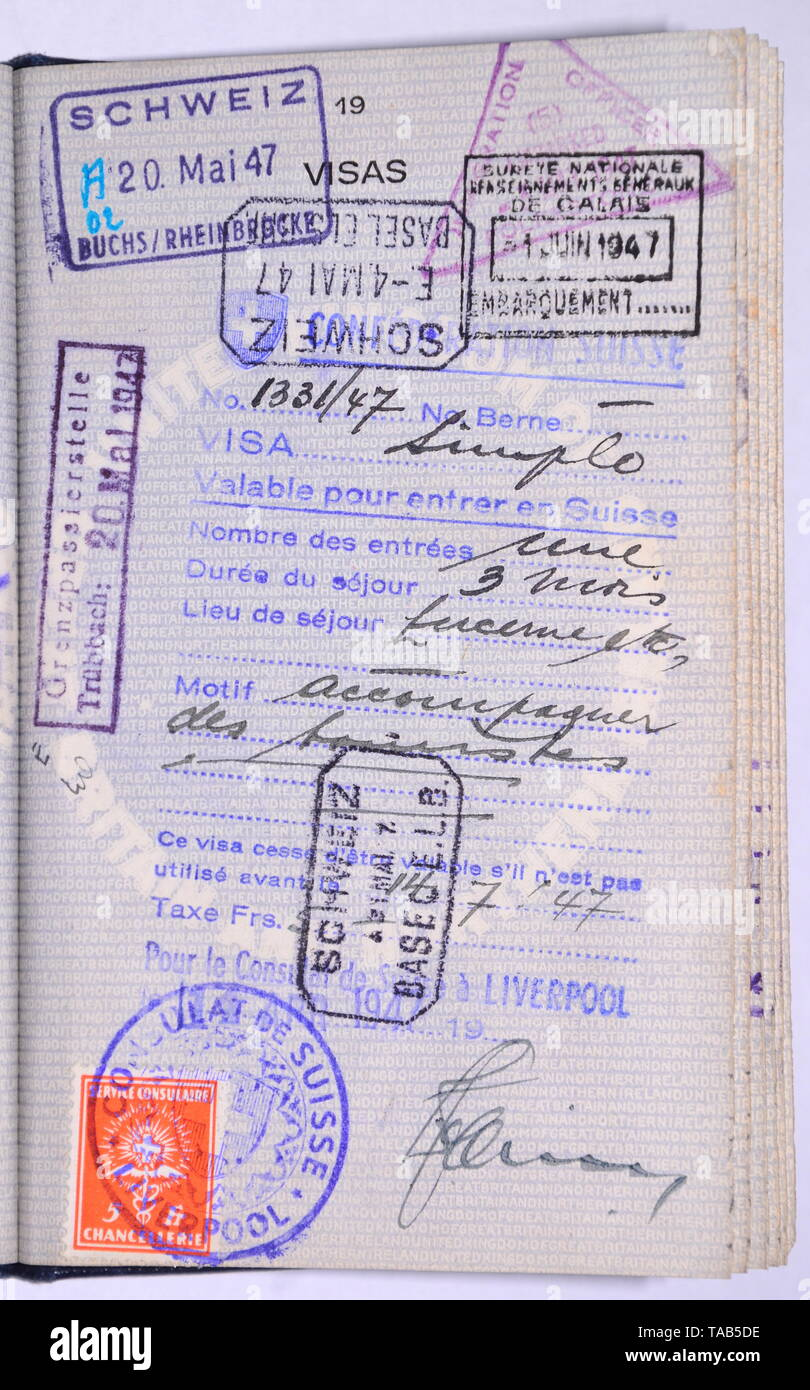 Page in 1940's vintage British blue passport with entry visa stamps - Stock Image