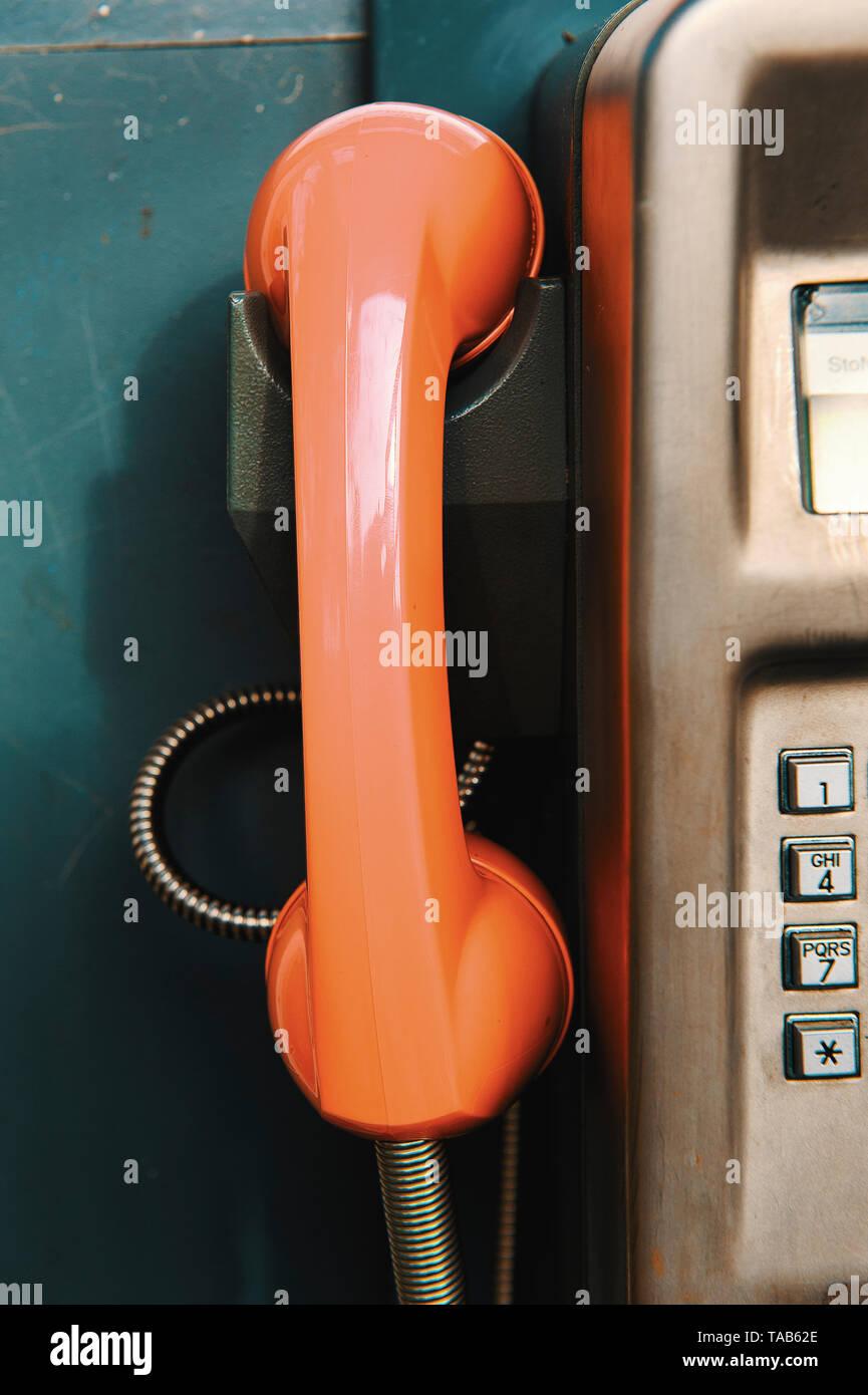 Orange Classical Telephone Box Phone - Stock Image