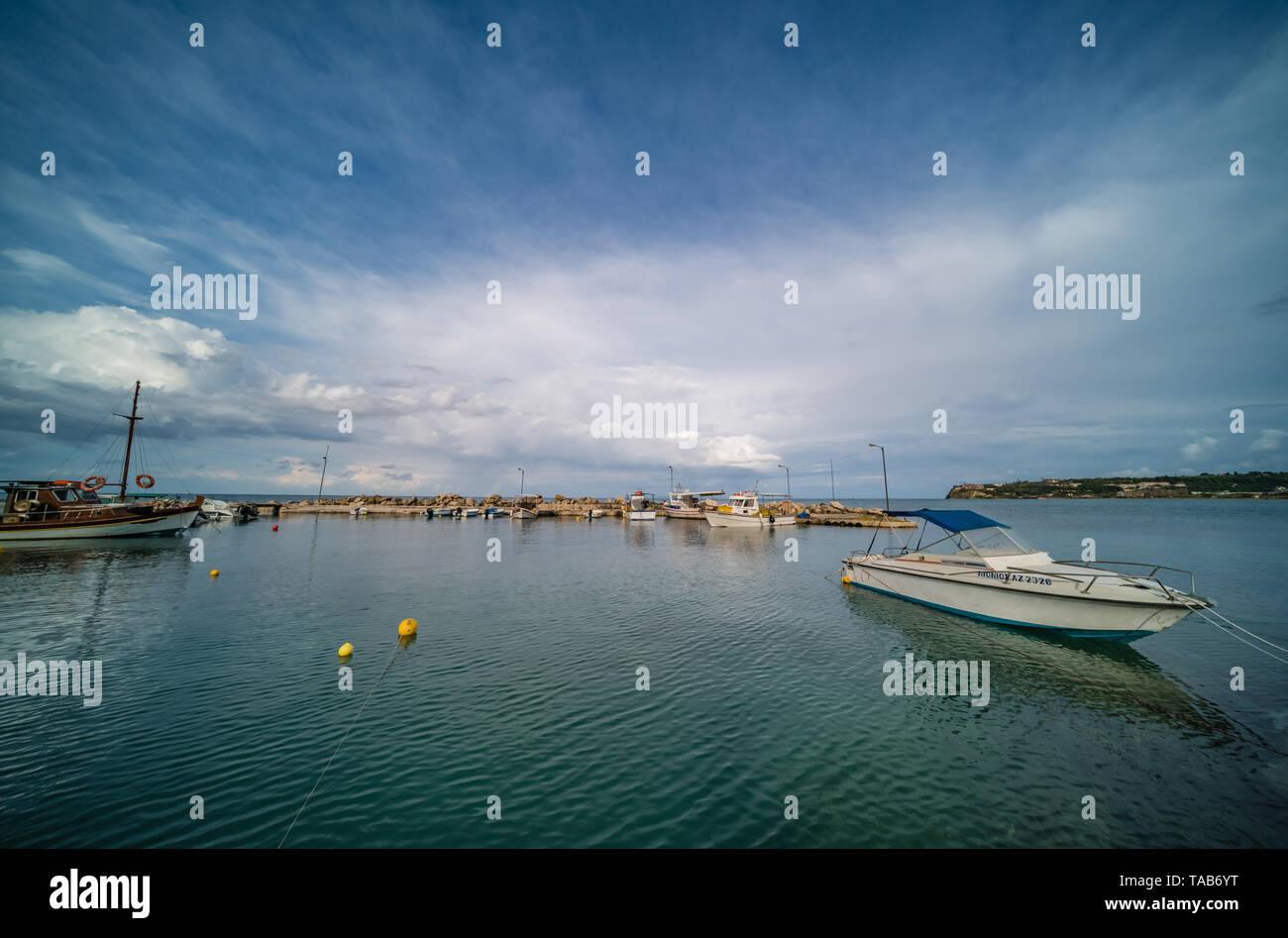 Zakynthos, Greece -  April 2019 : Wide angle view of the small private boats moored in port near Tsilivi beach in summer, Zante Island - Stock Image