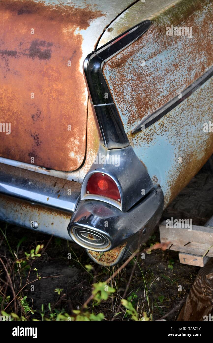 Rusty rear wing of a classic, 1957 Chevrolet Bel Air. - Stock Image