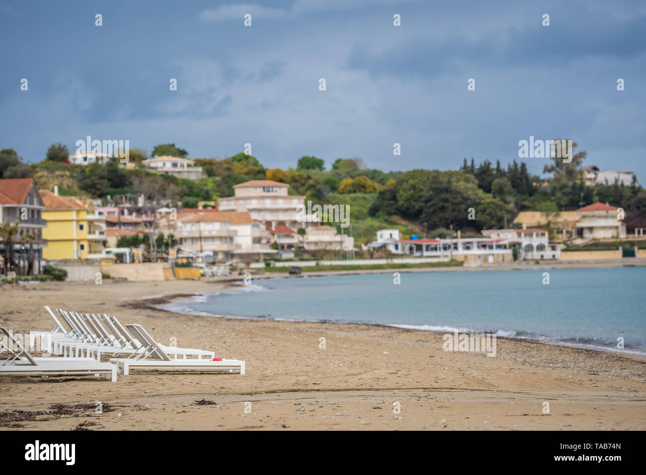 Zakynthos, Greece -  April 2019 : View of the empty white plastic sunbeds on Tsilivi Beach in summer on Zante Island - Stock Image