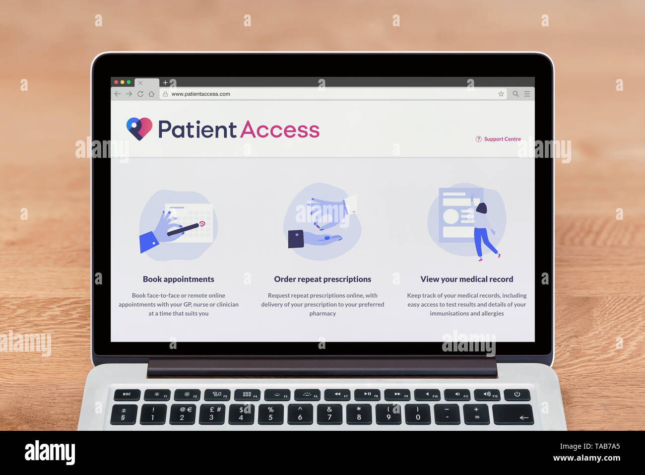An Apple Macbook displays the Patient Access website (Editorial use only). - Stock Image
