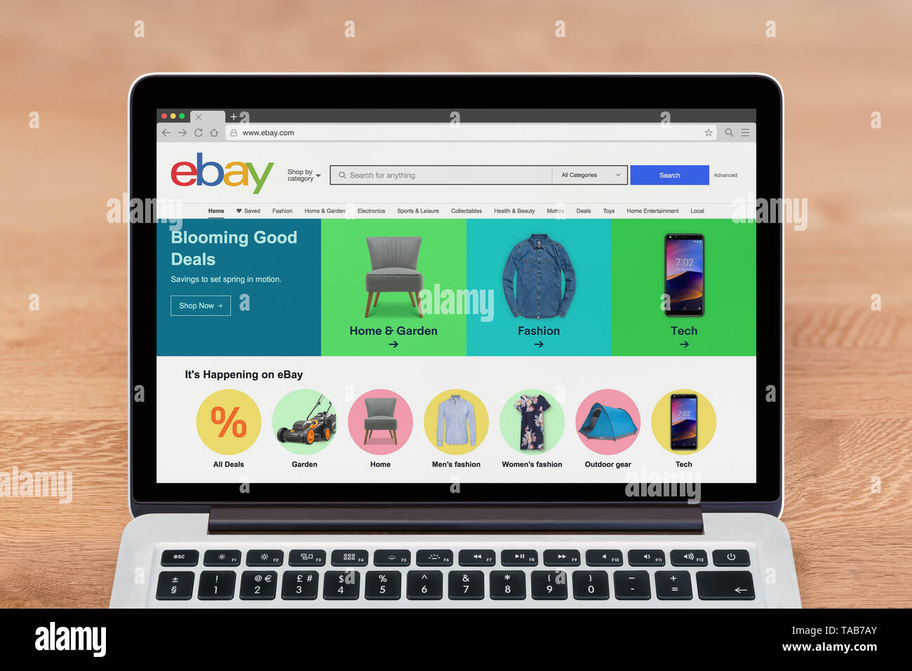 An Apple Macbook displays the Ebay website (Editorial use only). - Stock Image