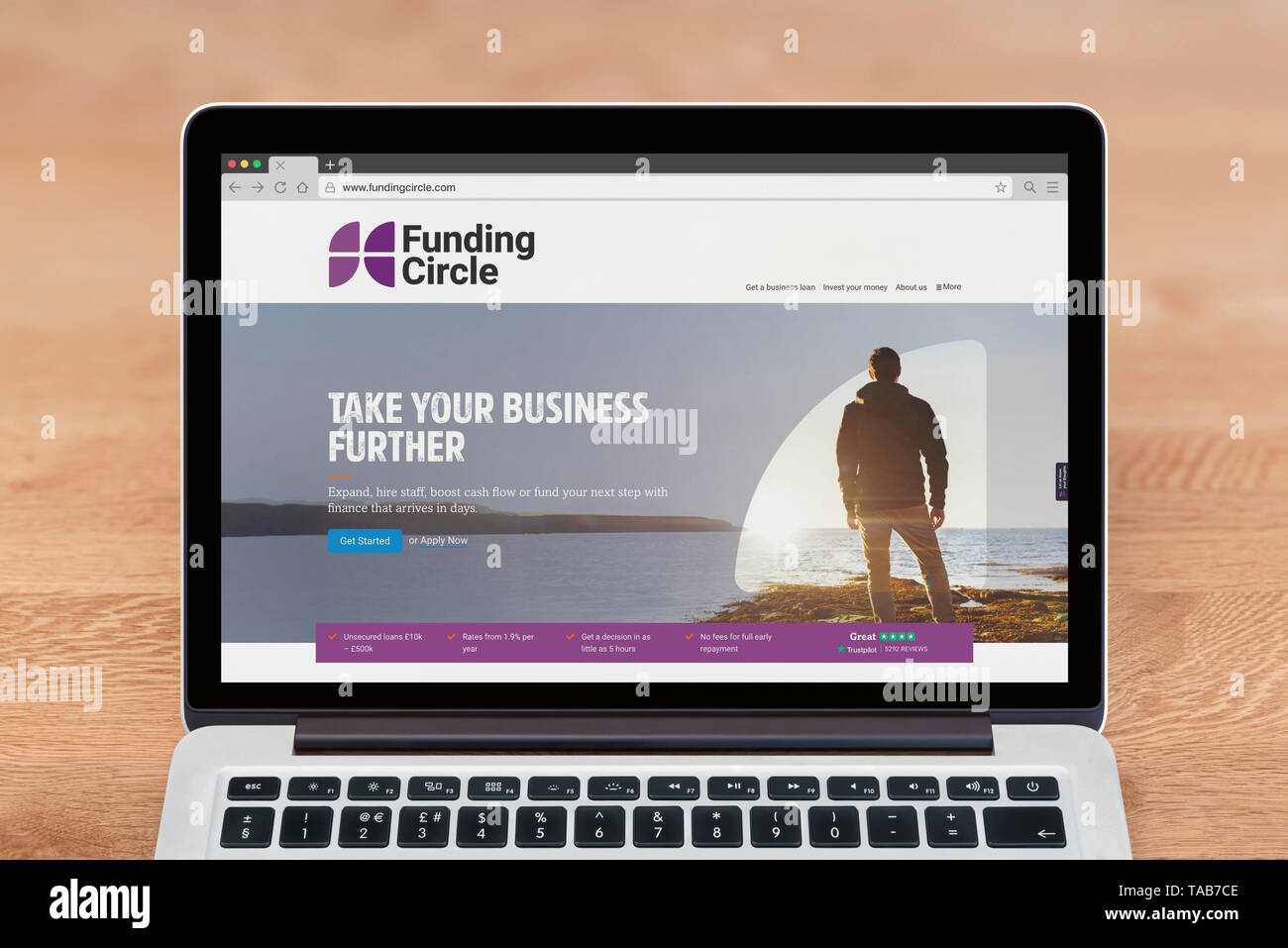 An Apple Macbook displays the Funding Circle website (Editorial use only). - Stock Image