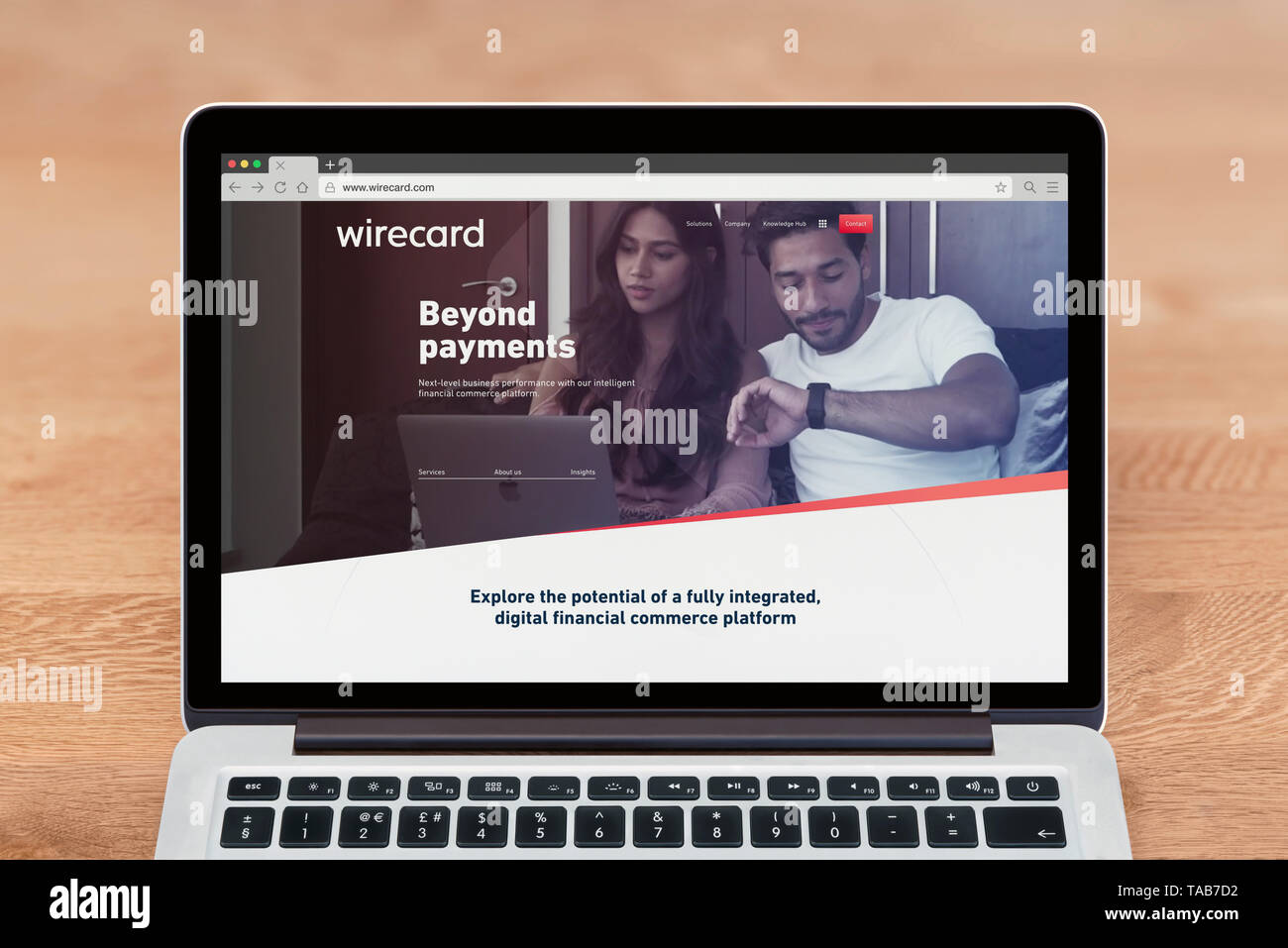 An Apple Macbook displays the Wirecard website (Editorial use only). - Stock Image