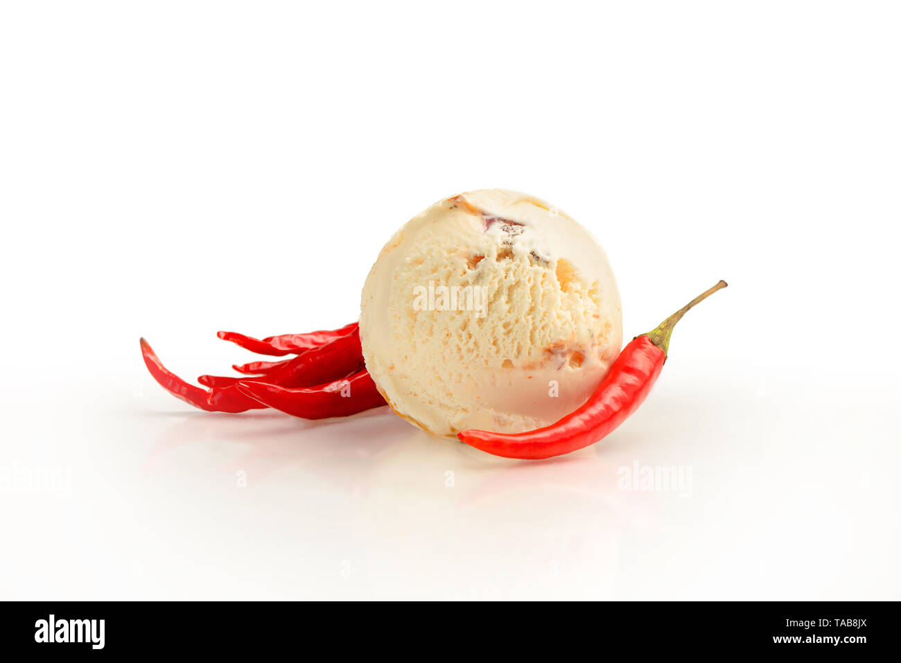 Ice cream ball, hot chili pepper and bacon and pine nuts flavor with ingredients, isolated on a white background. - Stock Image