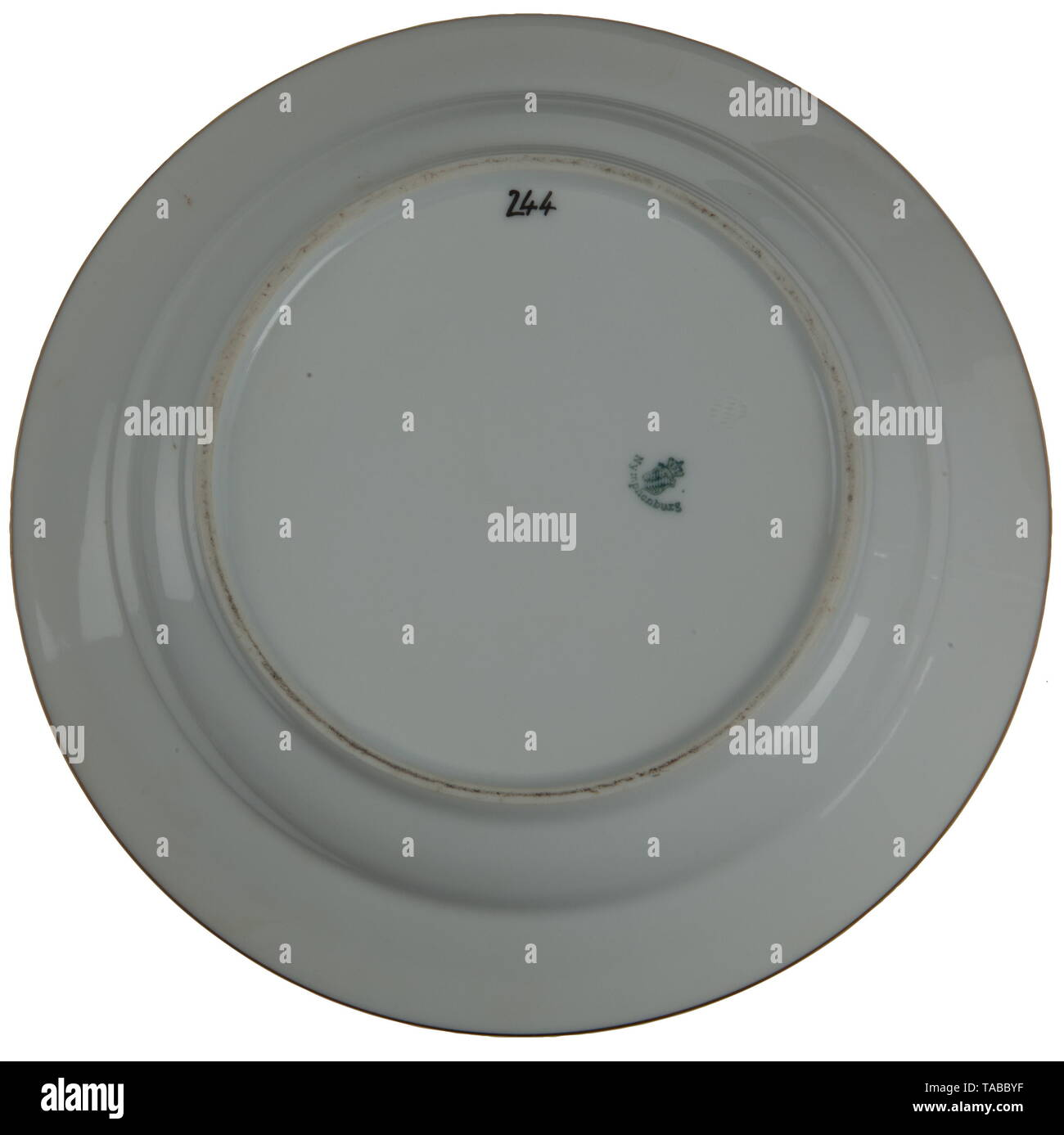 A pair of Deutsche Reichsbahn china plates from Göring's dining car Top edge of each plate has the German national eagle flanked by the letters 'DR' (Deutsche Reichsbahn, tr. German Railway Service). The underside of the plates are marked for the Nymphenburg Porcelain Manufactory, Munich. In addition to this logo, the number '244' appears in black numerals, representing the last three digits of one of Göring's dining cars, that is # 10244. These plates were taken from the dining car of Reichsmarschall Hermann Göring's Sonderzug (special train) at Berchtesgaden in May 1945, , Editorial-Use-Only - Stock Image