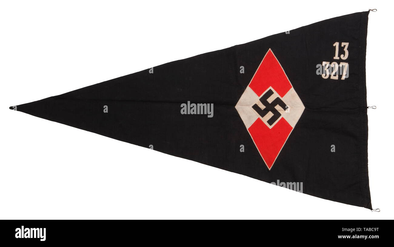 """A BDM/JM pennant Double-sided, multi piece cotton construction. Black with machine sewn red, black, and white HJ diamond. Upper corner embroidered with white chain stitched unit number """"13/327"""". Hoist edge retains three steel attachment clips. Approximately 100 x 55 cm. USA-lot, see page 4. historic, historical, 20th century, 1930s, League of German Girls, Band of German Maidens, youth organization, youth organizations, NS, National Socialism, Nazism, Third Reich, German Reich, Germany, National Socialist, Nazi, Nazi period, utensil, piece of equipment, utensils, object, ob, Editorial-Use-Only Stock Photo"""